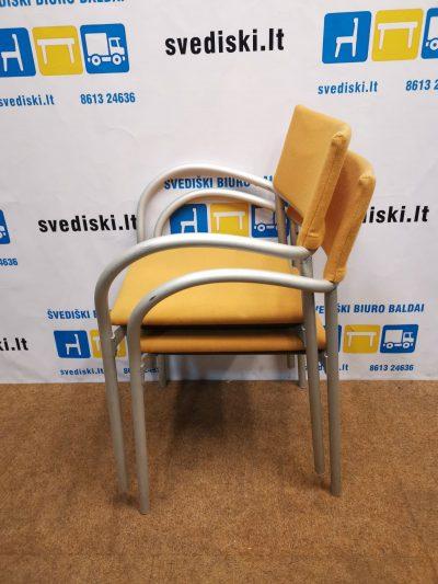 Oranžinė Lankytojo Kėdė Su Metaliniu Rėmu Ir Porankiais, Švedija